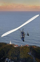Soar over the lighthouse and Cape Byron by microlight