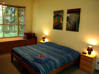 Modern guest rooms featuring local art - all with ensuite and views